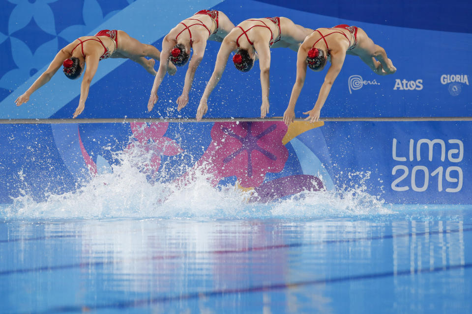 Members of Canada's artistic swimming team compete for the gold medal in the free routine event at the Pan American Games in Lima, Peru, Wednesday, July 31, 2019. (AP Photo/Moises Castillo)