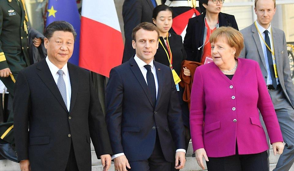 Xi, Macron and Merkel are seen after their meeting at the Elysee Presidential Palace in March 2019 in Paris. Photo: Corbis via Getty Images