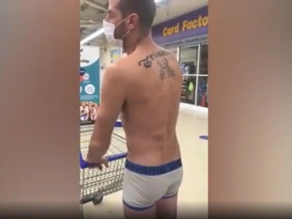 Chris Noden, 38, tried to enter a Tesco supermarket in Wales dressed in his underpants and a face mask in protest of the Welsh Government's ban on the sale of  'non-essential' items in supermarkets (Wales News Service)