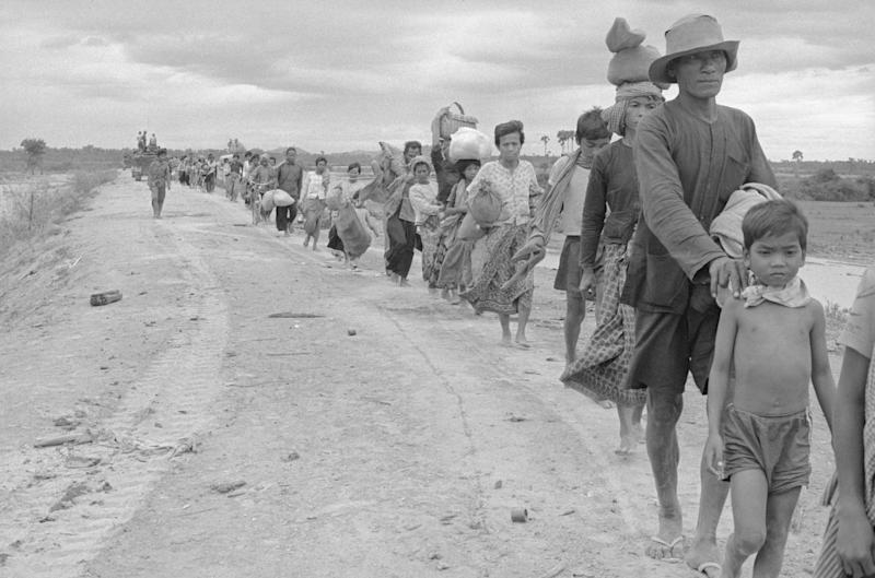 Long lines of refugees on the move some 17 kilometers from the capital in Cambodia in 1975 | Bettmann/Getty Images