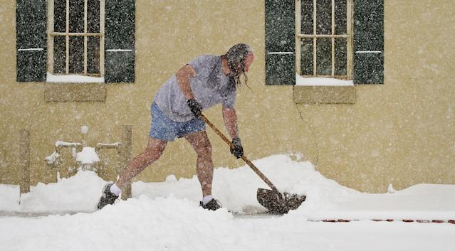 Troy Welty shovels snow in front of Mathew's Gallery where he works Tuesday, Feb. 4, 2014 in Wichita, Kan. South-central Kansas is expecting up to seven inches of snow as a winter storm passes through. (AP Photo/The Wichita Eagle, Mike Hutmacher) LOCAL TV OUT; MAGS OUT; LOCAL RADIO OUT; LOCAL INTERNET OUT