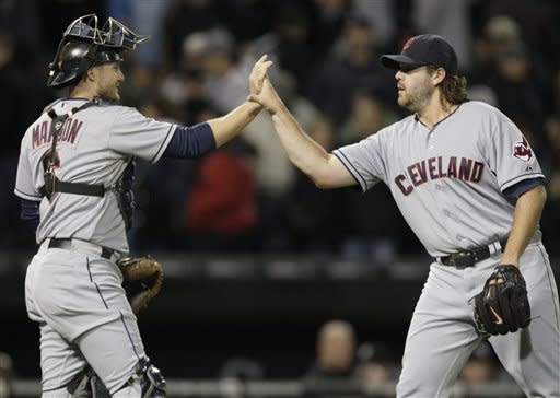 Cleveland Indians closer Chris Perez, right, celebrates with catcher Lou Marson after the Indians defeated the Chicago White Sox 6-4 in a baseball game in Chicago, Wednesday, Sept. 26, 2012. (AP Photo/Nam Y. Huh)