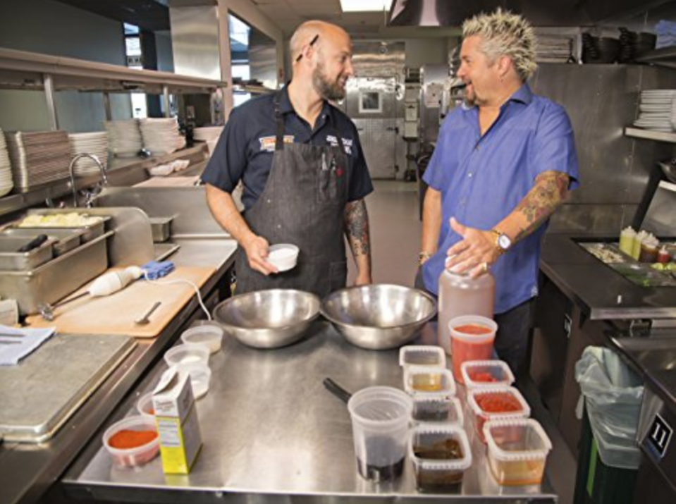 """<p>When it's time to film with Guy, everything must be ready to go. The production team asks the restaurants <a href=""""http://heavytable.com/david-page-of-diners-drive-ins-and-dives/"""" rel=""""nofollow noopener"""" target=""""_blank"""" data-ylk=""""slk:to prep all of their ingredients in advance"""" class=""""link rapid-noclick-resp"""">to prep all of their ingredients in advance</a> and sometimes to have multiples available.</p>"""