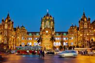 "Located in <a href=""https://www.cntraveler.com/story/what-to-do-in-mumbai-the-black-book?mbid=synd_yahoo_rss"" rel=""nofollow noopener"" target=""_blank"" data-ylk=""slk:Mumbai"" class=""link rapid-noclick-resp"">Mumbai</a> and immortalized in <em>Slumdog Millionaire,</em> this train station is a UNESCO World Heritage Site. It was built to commemorate Queen Victoria's Golden Jubilee in the late 1890s and now serves more than 3 million daily passengers traveling by commuter and intercity trains."