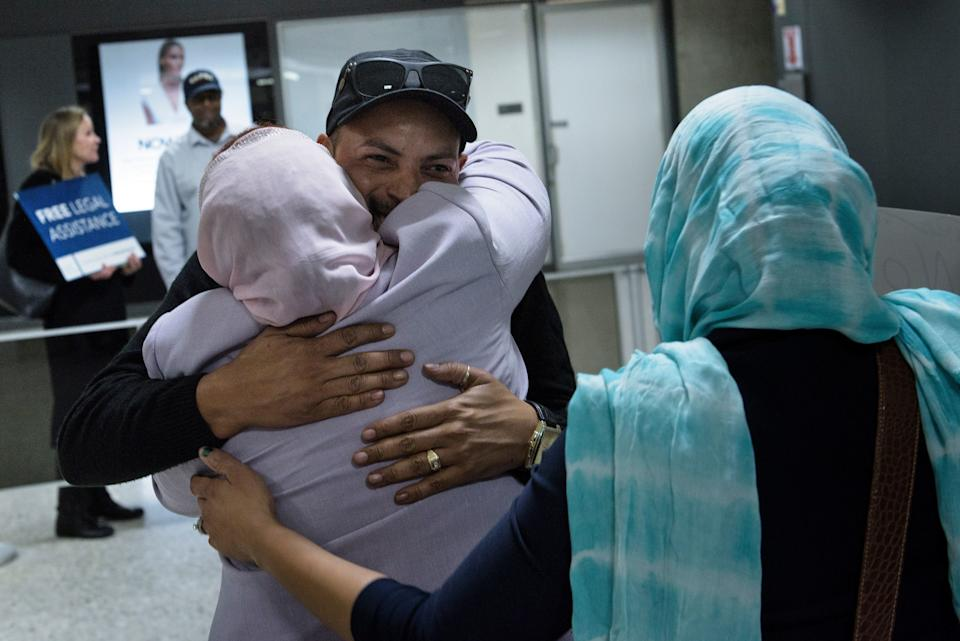 Salwa Tabiedi greets her son Hussamedin Agabani, a Sudanese citizen who was arriving in the United States for the first time, at the international arrivals hall at Washington Dulles International Airport on Feb. 6, 2017.