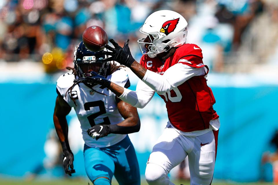 Cardinals wide receiver DeAndre Hopkins (10) catches a pass in front of Jacksonville Jaguars defensive back Rayshawn Jenkins (2) in the second quarter at TIAA Bank Field.