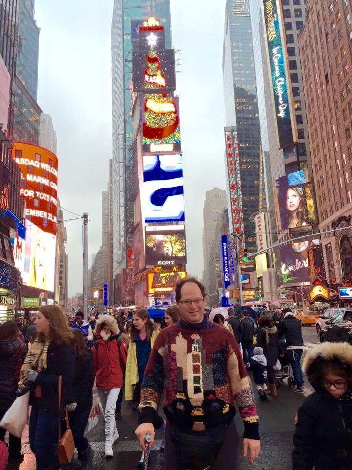 Sam Barsky shows off his handmade Times Square sweater... in Times Square. (Photo: Facebook)