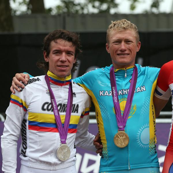 LONDON, ENGLAND - JULY 28: (L-R) Silver medallist Rigoberto Uran Uran of Colombia, gold medallist Alexandr Vinokurov of Kazakhstan, and bronze medallist Alexander Kristoff of Norway celebrate during the Victory Ceremony for the Men's Road Race Road Cycling on day 1 of the London 2012 Olympic Games on July 28, 2012 in London, England. (Photo by Bryn Lennon/Getty Images)