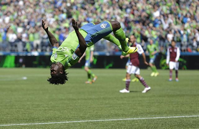 Seattle Sounders' Obafemi Martins does a backflip after he scored a goal against the Colorado Rapids, Saturday, April 26, 2014, in the second half of an MLS soccer match in Seattle. The Sounders defeated the Rapids 4-1. (AP Photo/Ted S. Warren)
