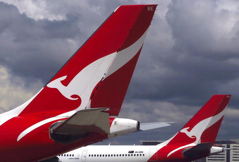 Two Qantas Airways Airbus A330 aircraft can be seen on the tarmac near the domestic terminal at Sydney Airport