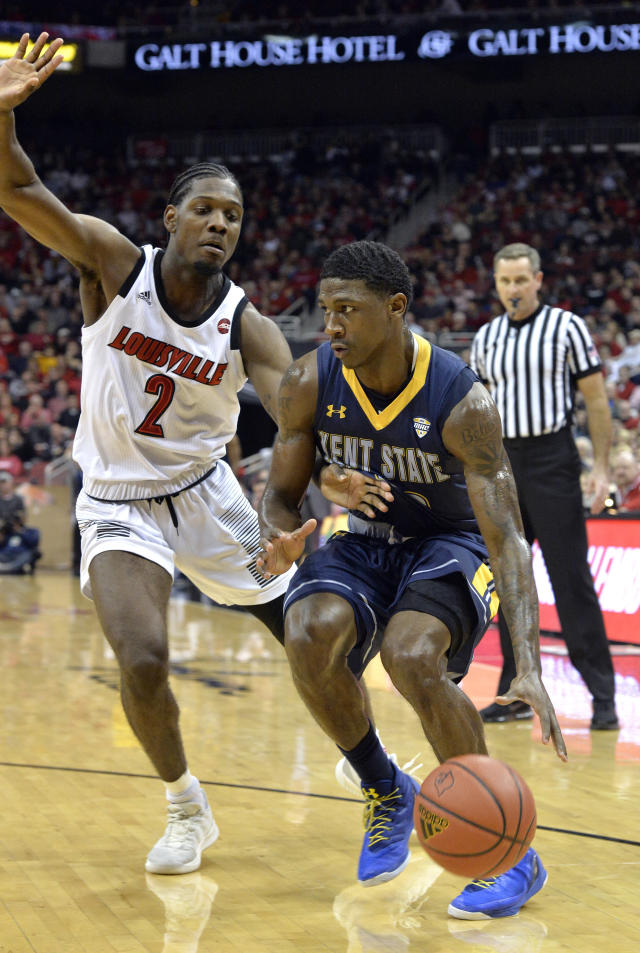 Kent State guard Jaylin Walker (23) attempts to drive past the defense of Louisville guard Darius Perry (2) during the first half of an NCAA college basketball game in Louisville, Ky., Saturday, Dec. 15, 2018. (AP Photo/Timothy D. Easley)