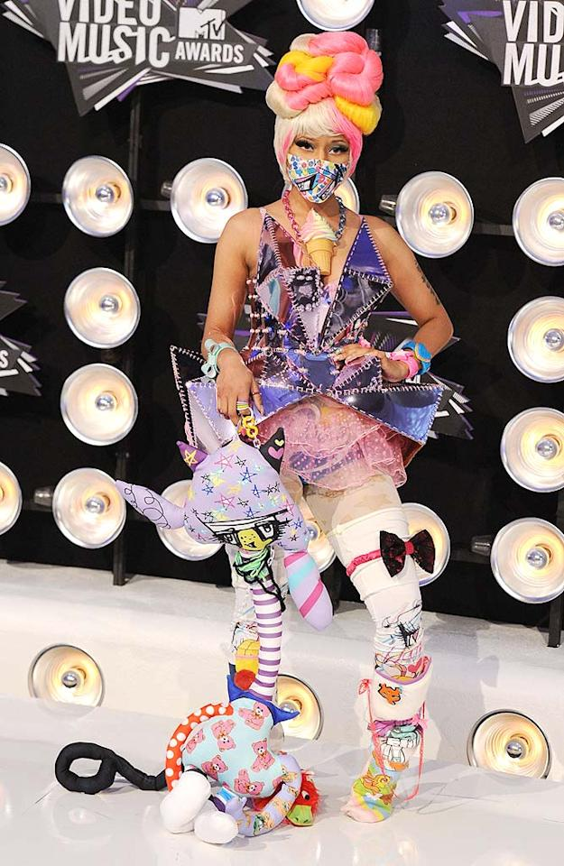 "Best Hip-Hop Video winner Nicki Minaj (""Super Bass"") arrived in the evening's most memorable (albeit bizarre) outfit, which consisted of a metallic bustier, pink tutu, and an array of outrageous accessories ... including a tasty-looking necklace. Steve Granitz/<a href=""http://www.wireimage.com"" target=""new"">WireImage.com</a> - August 28, 2011"