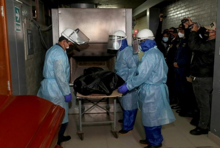 Guzman's remains headed for the furnace, according to this official photograph (AFP/ROLLY REYNA)