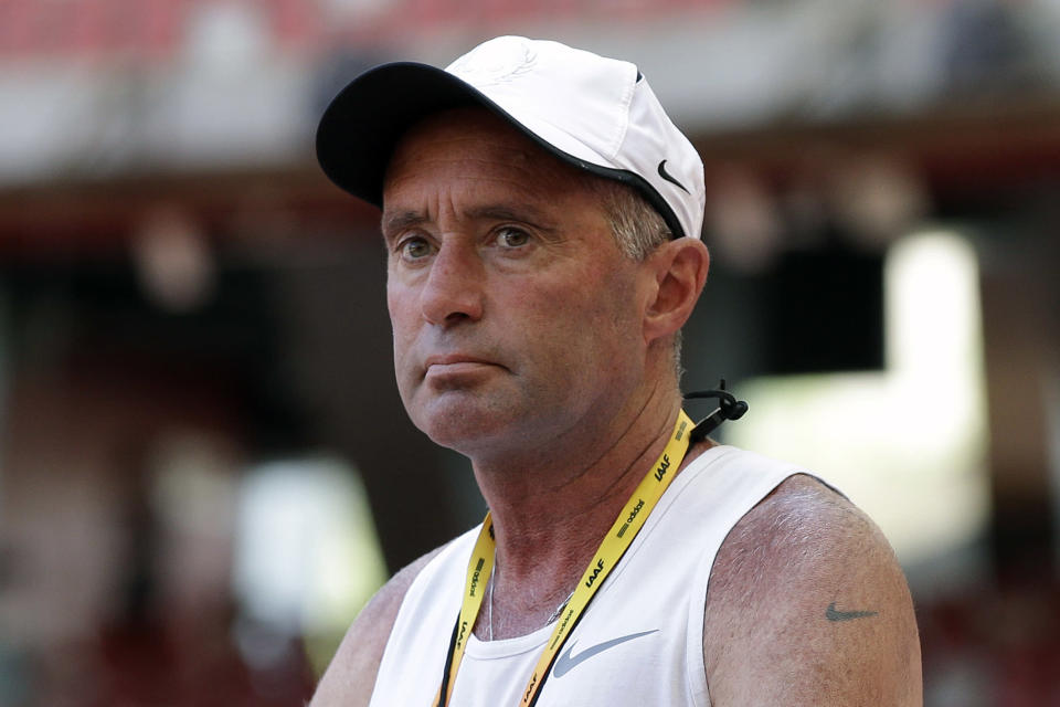 FILE - In this Aug. 21, 2015, file photo, Alberto Salazar watches a training session for the World Athletic Championships at the Bird's Nest stadium in Beijing. Though frequently scrutinized the way any market leader is, Nike's stranglehold on track and field has been tested over the past few years — if not in a pure dollar-for-dollar sense, then certainly in the way it is perceived by its most fervent followers. A sordid doping case involving Nike's most high-profile coach, Alberto Salazar, continues to play out this summer at the Court of Arbitration for Sport. (AP Photo/Kin Cheung, File)