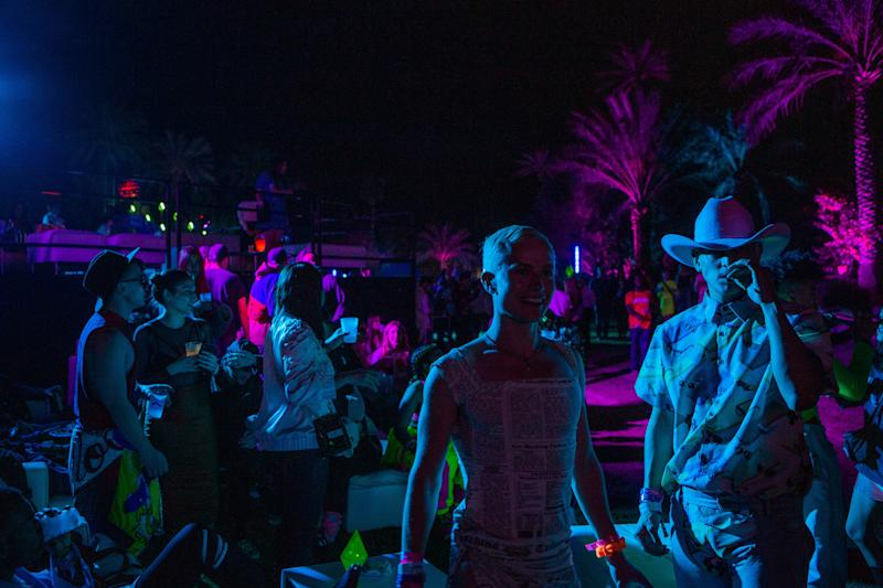 Guests attend the Moschino party in Indio, California, during weekend one of Coachella on Saturday, April 13, 2019. Photograph by Alex Welsh for W magazine.