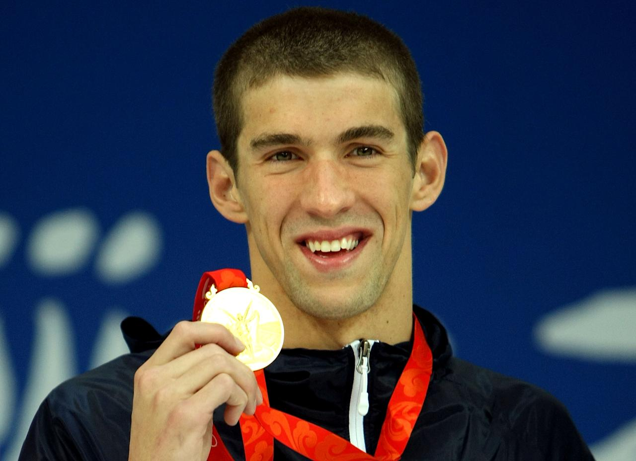 BEIJING - AUGUST 10:  Michael Phelps of the United States receives the gold medal during the medal ceremony for the Men's 400m Individual Medley event held at the National Aquatics Center during day 2 of the Beijing 2008 Olympic Games on August 10, 2008 in Beijing, China.  Michael Phelps of the United States finshed the race in a time of 4:03:84, a new World Record.  (Photo by Al Bello/Getty Images)