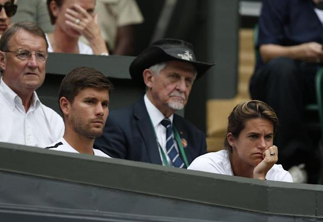 Coach of Andy Murray of Britain Amelie Mauresmo, right, watches Murray's first round match against David Goffin of Belgium at the All England Lawn Tennis Championships in Wimbledon, London, Monday, June 23, 2014. (AP Photo/Pavel Golovkin)