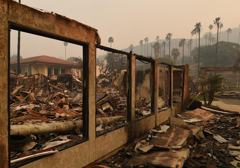 A wall stands in the burned-out Vista del Mar Hospital after the Thomas wildfire swept through Ventura, California, on Wednesday. (MARK RALSTON via Getty Images)