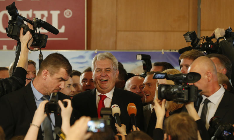 Presidential candidate Milos Zeman smiles while addressing the media after the announcement of the preliminary results of the presidential elections in Prague, Czech Republic, Saturday, Jan. 26, 2013. According to the preliminary results he won the election with about 54.8 percent. (AP Photo/Petr David Josek)