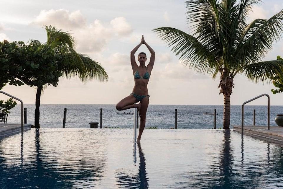 Yoga overlooking the beach at BodyHoliday (BodyHoliday/PA)