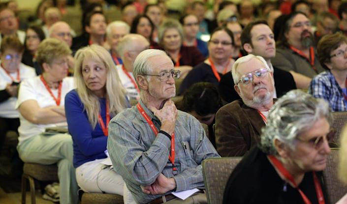 """<span class=""""caption"""">People in attend a talk at the American Atheists National Convention in 2014. Many Americans remain distrustful of atheists, surveys show.</span> <span class=""""attribution""""><a class=""""link rapid-noclick-resp"""" href=""""https://newsroom.ap.org/detail/AtheistConferenceUtah/7b1a427c335b4a6695c09ebfdc631e31/photo?Query=atheist&mediaType=photo&sortBy=&dateRange=Anytime&totalCount=338&currentItemNo=8"""" rel=""""nofollow noopener"""" target=""""_blank"""" data-ylk=""""slk:AP Photo/Rick Bowmer"""">AP Photo/Rick Bowmer</a></span>"""