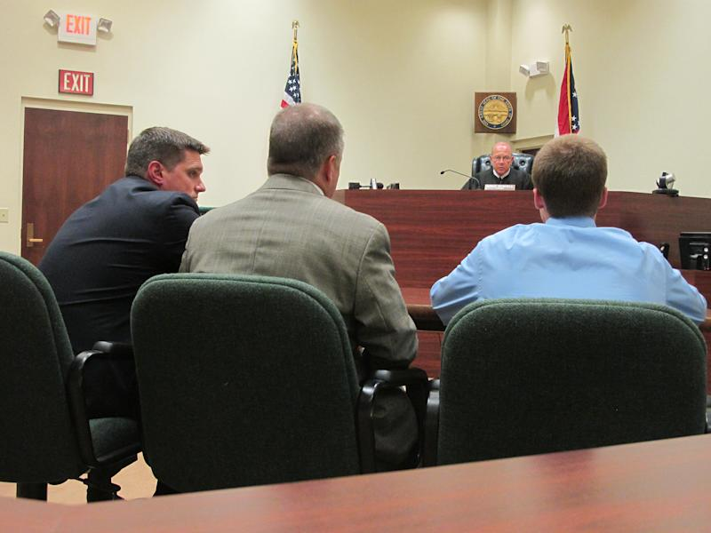 In this Tuesday, July 31 2012 photo, Warren County Juvenile Court Judge Mike Powell warns 17-year-old Ohio high school student Tyler Pagenstecher, right, of the consequences of admitting guilt at his first hearing in Lebanon, Ohio. Pagenstecher pleaded guilty to drug-trafficking charges in juvenile court and will be sentenced Monday, Oct. 22, 2012. Police say he played a major role in a drug ring that sold as much as $20,000 worth of high-grade marijuana a month to fellow students at two high schools. (AP Photo/Amanda Lee Myers)