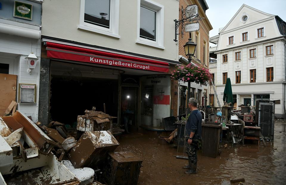 A resident reacts in front of damaged furnitures following heavy rains and floods in Ahrweiler-Bad Neenah, western Germany, on July 15, 2021. - German authorities said late July 15, 2021 that at least 58 people had likely died in massive storms and flooding in the country's west, an increase on the earlier toll of 45 dead. (Photo by Christof STACHE / AFP) (Photo by CHRISTOF STACHE/AFP via Getty Images)