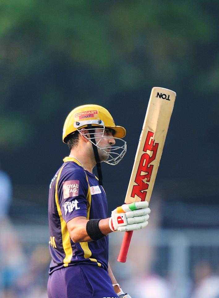 Kolkata Knight Riders batsman Gautam Gambhir celebrate his half-century (50 runs) during the IPL Twenty20 cricket match between Kolkata Knight Riders and Pune Warriors India at The Eden Gardens in Kolkata on May 5, 2012.  RESTRICTED TO EDITORIAL USE. MOBILE USE WITHIN NEWS PACKAGE.  AFP PHOTO/Dibyangshu SARKAR        (Photo credit should read DIBYANGSHU SARKAR/AFP/GettyImages)