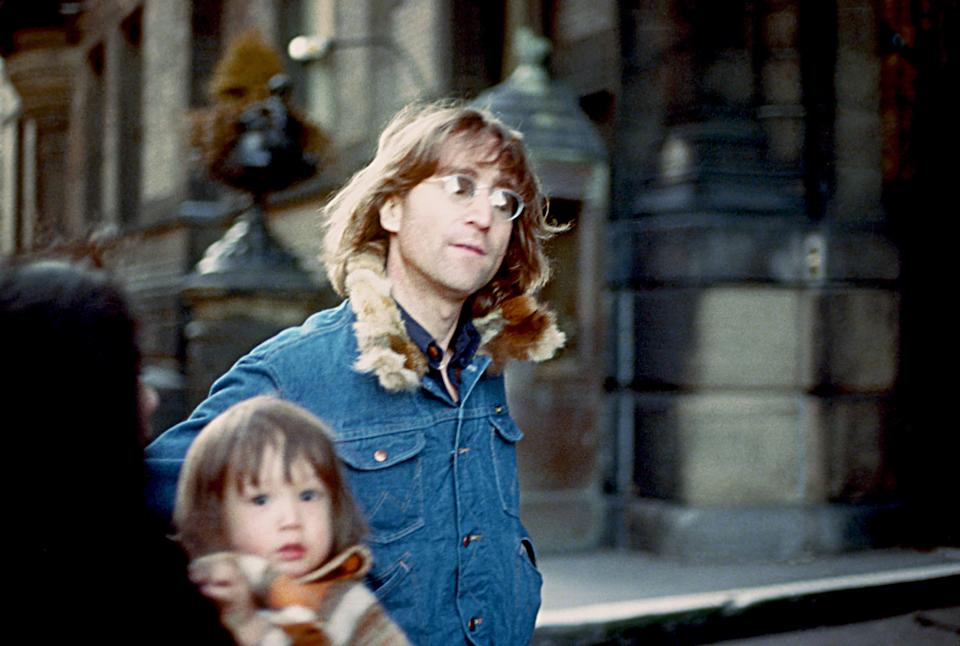 John Lennon poses for a photo with his wife Yoko Ono and son Sean Lennon in 1977 in New York City, New York. (Photo by Vinnie Zuffante/Michael Ochs Archives/Getty Images)