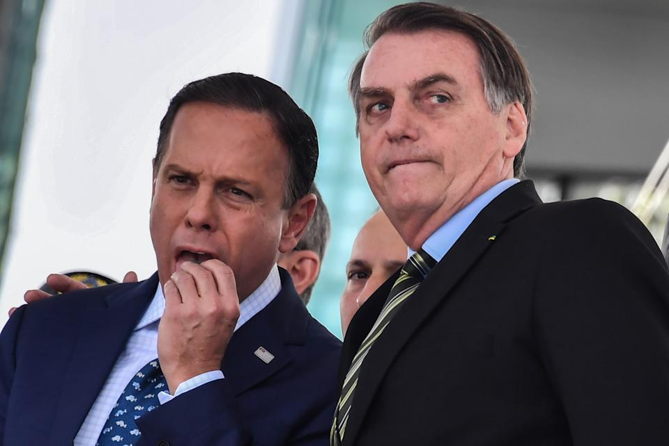 Brazilian President Jair Bolsonaro (R) and Sao Paulo's Governor Joao Doria attend a military event in Sao Paulo, Brazil, on October 11, 2019. (Photo by NELSON ALMEIDA / AFP) (Photo by NELSON ALMEIDA/AFP via Getty Images)