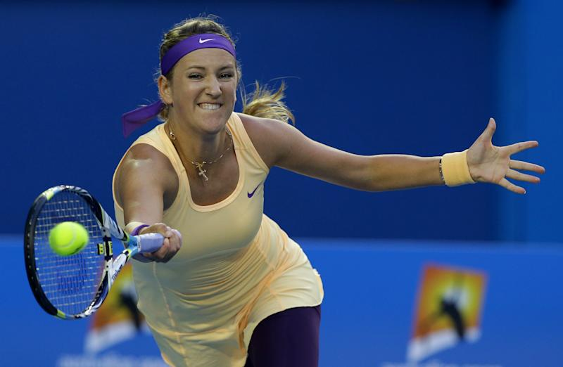 Victoria Azarenka of Belarus hits a forehand return to China's Li Na during the women's final at the Australian Open tennis championship in Melbourne, Australia, Saturday, Jan. 26, 2013.  (AP Photo/Aaron Favila)