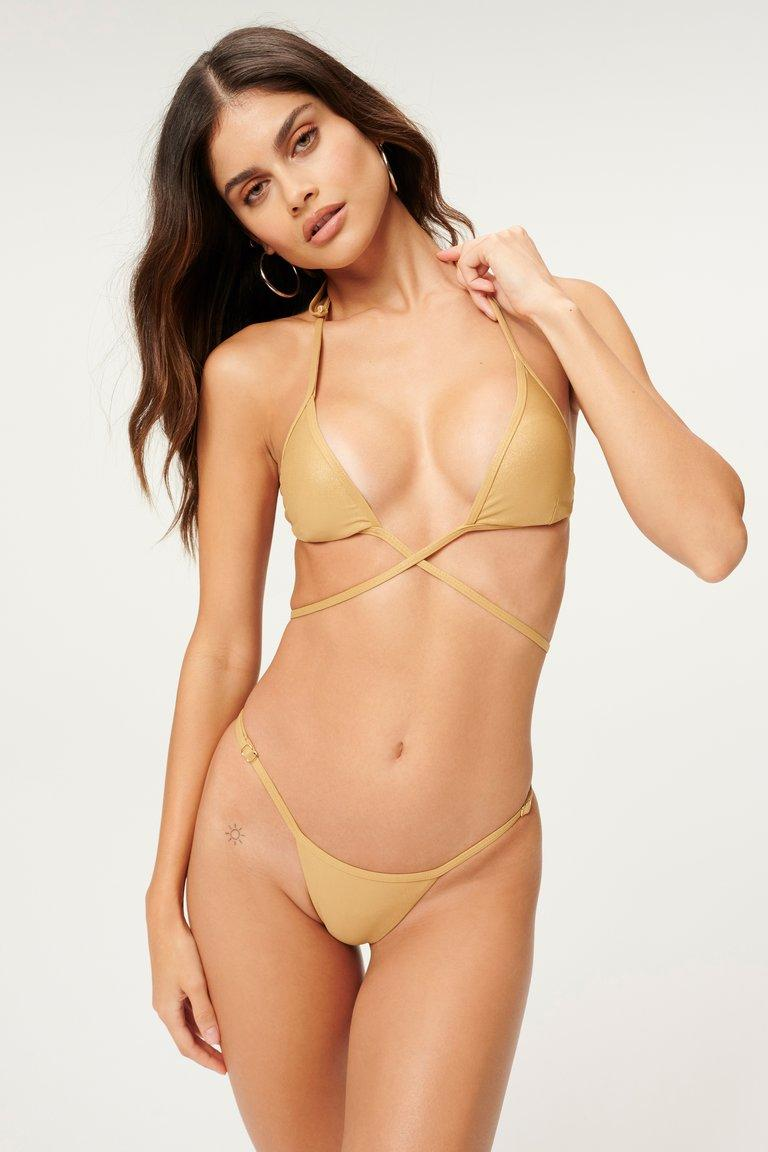 Kylie Jenner was spotted in the Metallic Bikini Wrap Top and Metallic Perfect Fit Bottom from Good American.