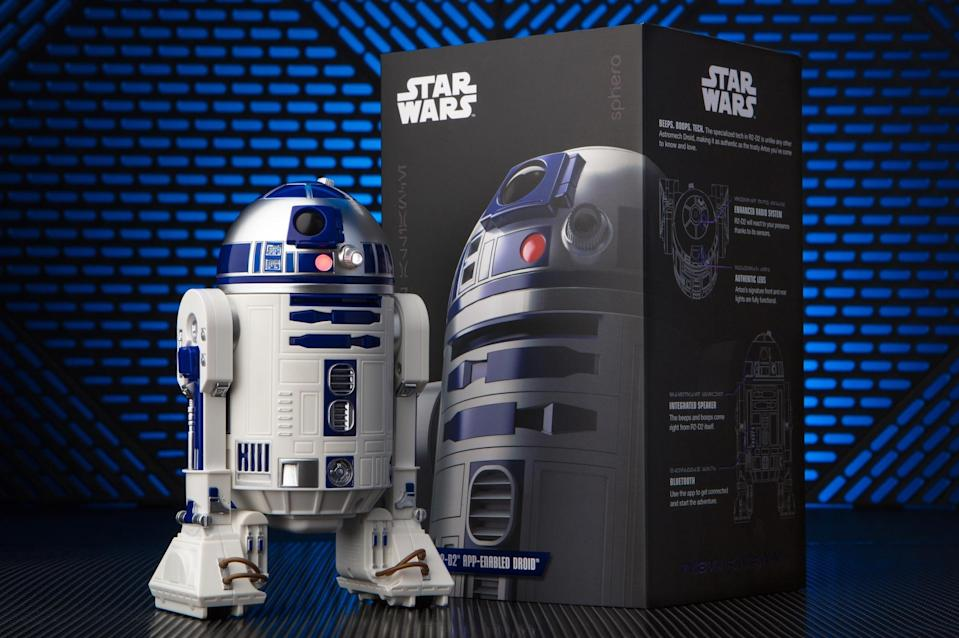 """<p>The robot-making whizzes at Sphero one-up <a href=""""https://www.yahoo.com/entertainment/bb-8-remote-controlled-toy-star-wars-the-force-128264274727.html"""" data-ylk=""""slk:last year's phenomenal BB-8;outcm:mb_qualified_link;_E:mb_qualified_link;ct:story;"""" class=""""link rapid-noclick-resp yahoo-link"""">last year's phenomenal BB-8</a> with this interactive version of the OG astromech, R2-D2. Remote-controlled via smartphone and featuring Lucasfilm-sanctioned light and sound effects, Artoo is equipped to roam around your home, reveal holographic messages, react to <em>Star Wars</em> movies, and even communicate with fellow app-enabled droids BB-8 and the evil BB-9E. Like the box says, this is the droid you're looking for.<br><strong>Buy: <a href=""""https://www.walmart.com/ip/Sphero-R2-D2-App-Enabled-Droid/56081736"""" rel=""""nofollow noopener"""" target=""""_blank"""" data-ylk=""""slk:Walmart"""" class=""""link rapid-noclick-resp"""">Walmart</a></strong> </p>"""