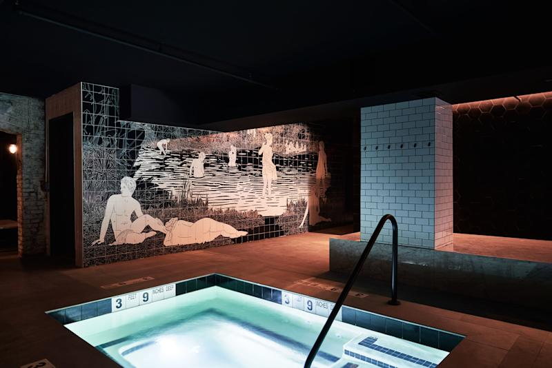 The thermal pool in front of a mural by Amit Greenberg.