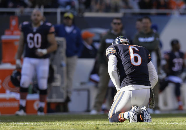 Chicago Bears quarterback Jay Cutler (6) kneels on the field after a play during the second half of an NFL football game against the Detroit Lions, Sunday, Nov. 10, 2013, in Chicago. (AP Photo/Nam Y. Huh)