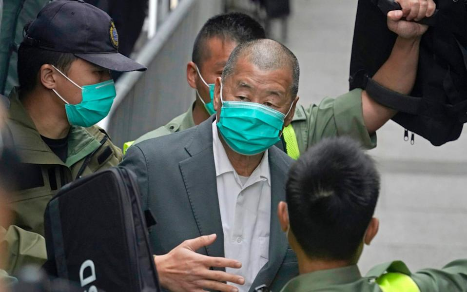 Newspaper publisher and pro-democracy advocate Jimmy Lai was charged with colluding with foreign forces - AP