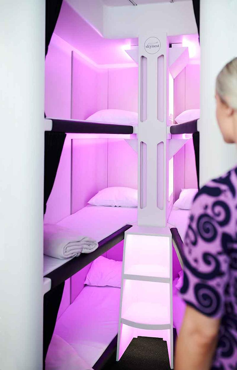 Air hostess looks at Airnest six bed pods