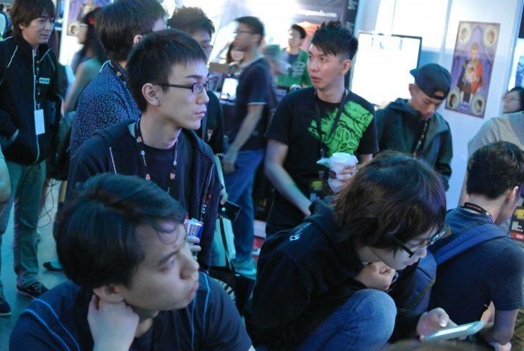 The world's top Street Fighter V players watch the competition unfold at SEAM 2016