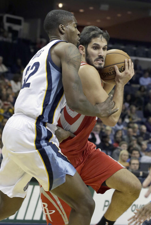 Memphis Grizzlies' Ed Davis (32) defends against Houston Rockets' Omri Casspi, right, of Israel, during the first half of an NBA preseason basketball game in Memphis, Tenn., Friday, Oct. 25, 2013. Casspi scored 11 points in Houston's 92-73 victory over Memphis. (AP Photo/Danny Johnston)