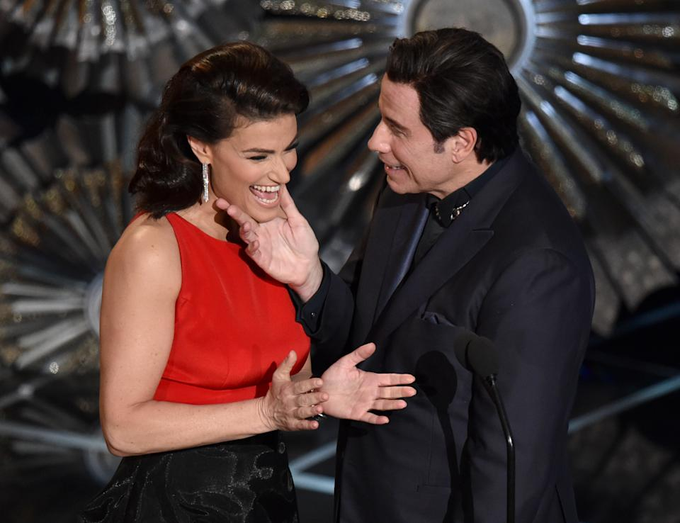 Idina Menzel, left, and John Travolta present the award for best original song at the Oscars on Sunday, Feb. 22, 2015, at the Dolby Theatre in Los Angeles. (Photo by John Shearer/Invision/AP)