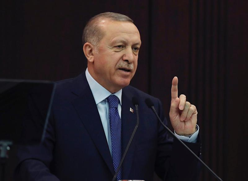 Turkey's President Recep Tayyip Erdogan speaks after a coronavirus meeting with his ministers, in Ankara on March 18.