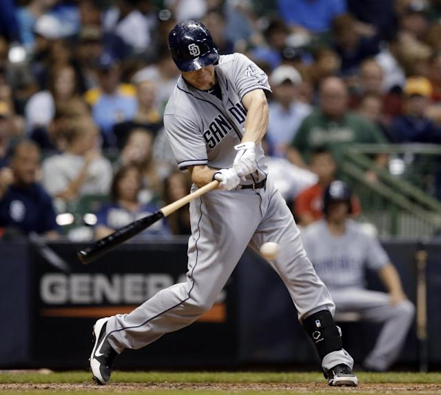 San Diego Padres' Chase Headley hits an RBI single during the seventh inning of a baseball game against the Milwaukee Brewers on Tuesday, July 23, 2013, in Milwaukee. (AP Photo/Morry Gash)