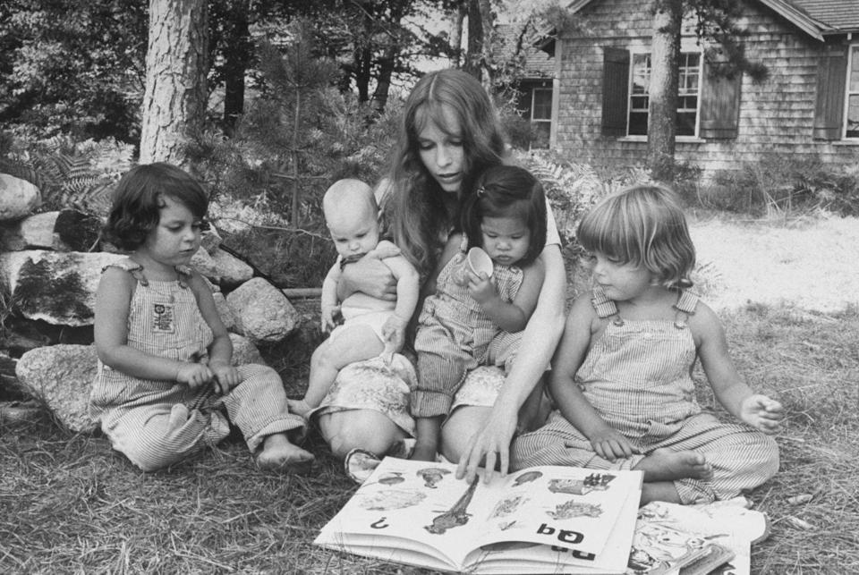 <p>While vacationing in Martha's Vineyard, Mia spends a warm summer day outside with four of her children in 1974. She was on holiday with her husband, André Previn. </p>