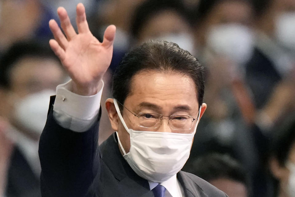 Japan's former Foreign Minister Fumio Kishida waves as he won in the Liberal Democrat Party leadership election in Tokyo Wednesday, Sept. 29, 2021. Kishida has won the governing party leadership election and is set to be become the next prime minister. (Kyodo News via AP)