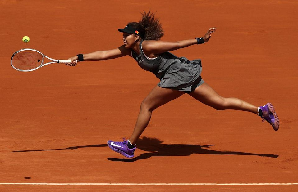 <p>Naomi Osaka gives it her all on Friday during her first round match at the Mutua Madrid Open in Spain.</p>