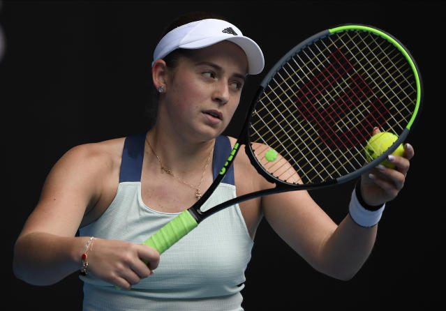 Latvia's Jelena Ostapenko prepares to serve to Switzerland's Belinda Bencic during their second round singles match at the Australian Open tennis championship in Melbourne, Australia, Thursday, Jan. 23, 2020. (AP Photo/Andy Brownbill)