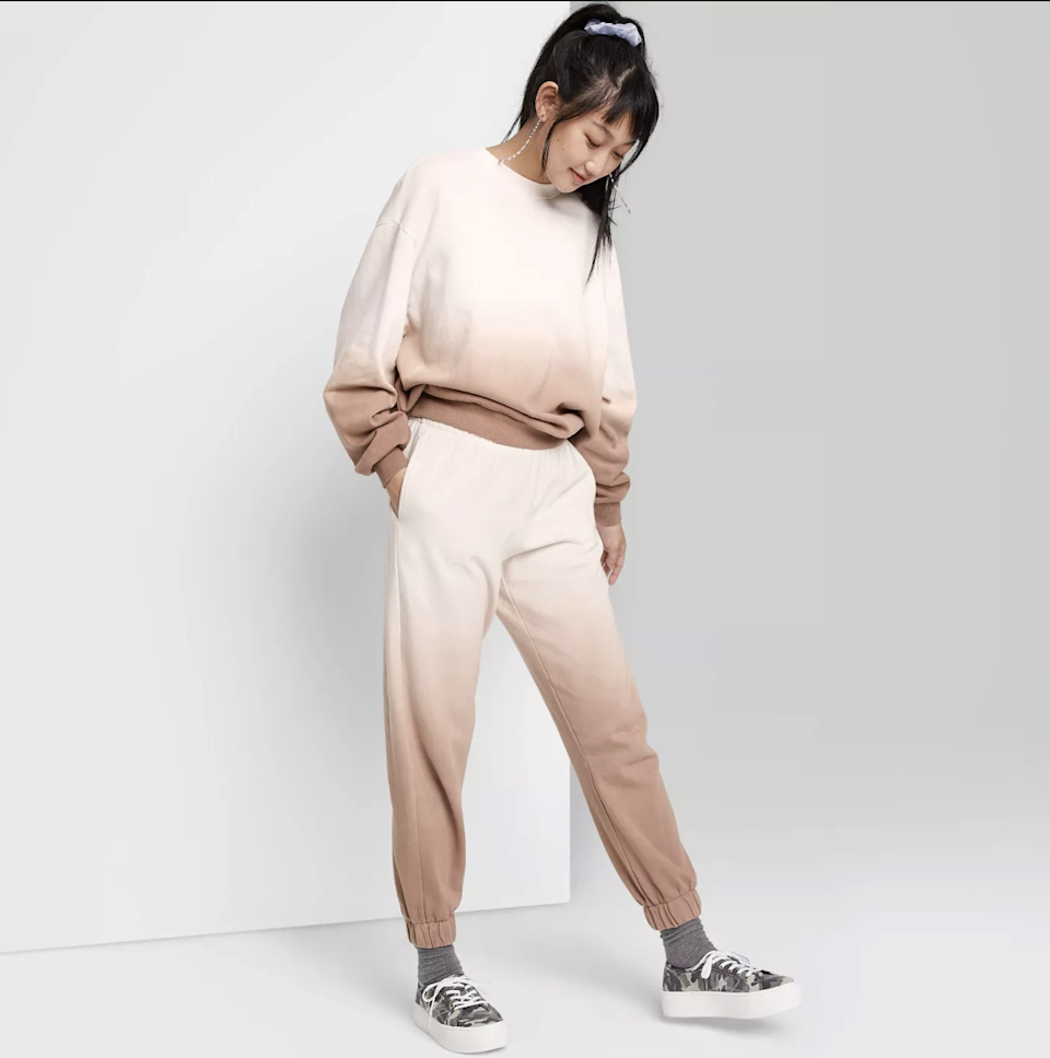 """<p>Comfortable two-piece sets like Wild Fable's High-Rise Vintage Jogger Sweatpants and matching Oversized Sweatshirt make getting dressed in the morning (or just rolling out of bed and logging into work) so easy. The subtle ombre pattern makes it feel a bit more fashionable than a solid, monochromatic sweatsuit. </p> <p><strong>Sizes available:</strong> XS to 4XL</p> <p><strong>$22 for the sweatshirt</strong> (<a href=""""https://www.target.com/p/women-s-oversized-sweatshirt-wild-fable/-/A-79836346?preselect=80586965#lnk=sametab"""" rel=""""nofollow noopener"""" target=""""_blank"""" data-ylk=""""slk:Shop Now"""" class=""""link rapid-noclick-resp"""">Shop Now</a>) and <strong>$22 for the joggers</strong> (<a href=""""https://www.target.com/p/women-s-high-rise-vintage-jogger-sweatpants-wild-fable/-/A-79811119?preselect=54674222#lnk=sametab"""" rel=""""nofollow noopener"""" target=""""_blank"""" data-ylk=""""slk:Shop Now"""" class=""""link rapid-noclick-resp"""">Shop Now</a>)</p>"""