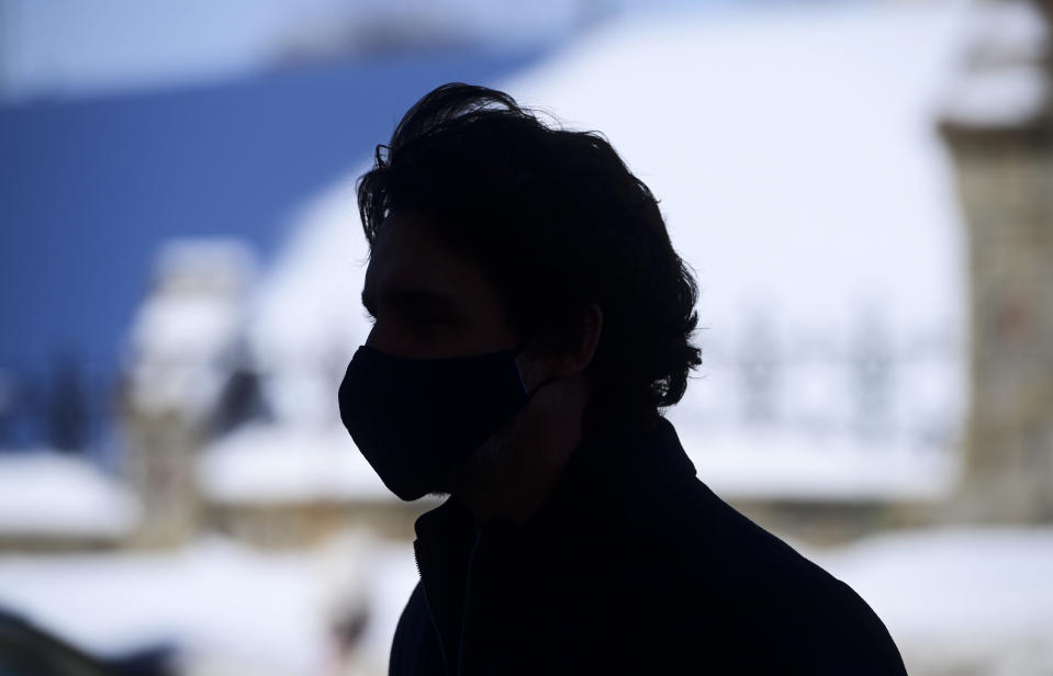 Canadian Prime Minister Justin Trudeau makes his way to hold a press conference in Ottawa, Ontario, on Friday, Feb. 26, 2021, to provide an update on the COVID-19 pandemic and vaccine roll-out in Canada. (Sean Kilpatrick/The Canadian Press via AP)