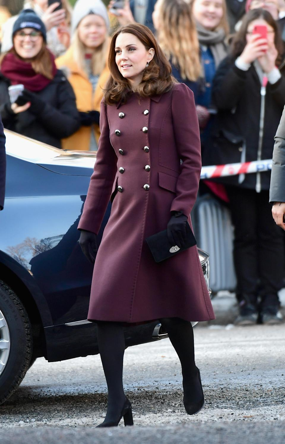 <p><strong>The occassion:</strong> A visit to Hartvig Nissen School in Oslo on day four of the Duke and Duchess's Royal Tour to Sweden and Norway.<br><strong>The look:</strong> A burgundy double-breasted Dolce & Gabbana coat with black tights and heels. <br>[Photo: Getty] </p>