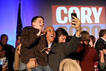 U.S. Senator Cory Booker (D-NJ) takes photos with supporters after speaking during his 2020 U.S. presidential campaign in Des Moines, Iowa, U.S., February 9, 2019. REUTERS/Scott Morgan